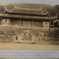 One of the temples at Monastery (No. 22). Buddhists in fore-ground - four of them holding beads-rosaries. Foreigners are Dr. S.L. Gracey and youngest son